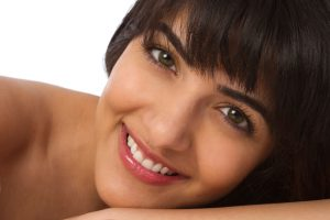 Woman with a beautiful smile thanks to the southlake cosmetic dentist