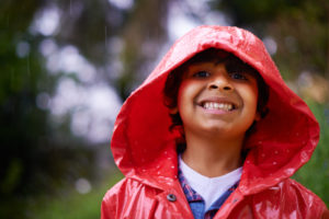 little boy smiling in raincoat