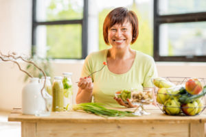 woman smiling eating lunch