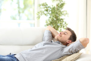 man resting on the couch
