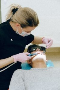 Dentist in Southlake performing dental treatment.