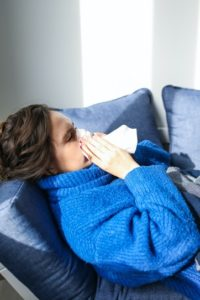 Woman with a cold at holistic dentist in Southlake.