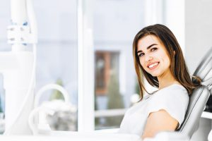 Happy female patient visiting holistic dentist in Southlake