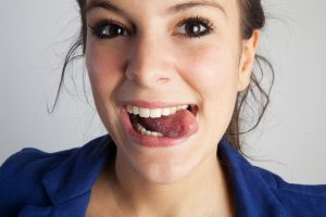 Woman sticking out tongue after tongue tie release in Southlake