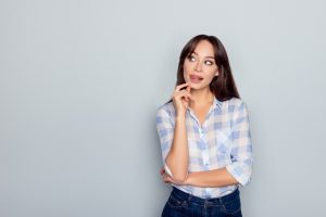 Woman sticking out her tongue, considering visiting holistic dentist in Southlake